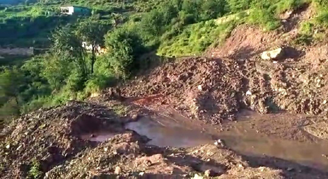 Ramnagar to Basantgarh Road which is lying closed due to landslide.