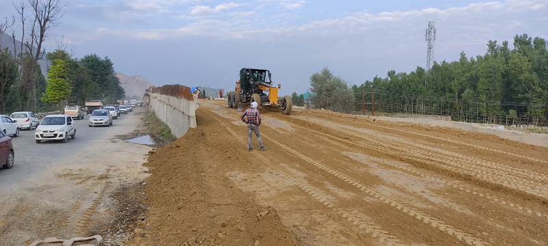 Construction work on Lasjan grade separator underway on the outskirts of Srinagar on Wednesday. - Excelsior/Shakeel