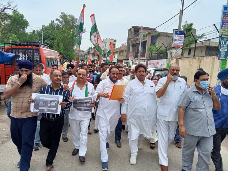 Cong leaders and workers taking out protest rally at Bishnah on Wednesday.