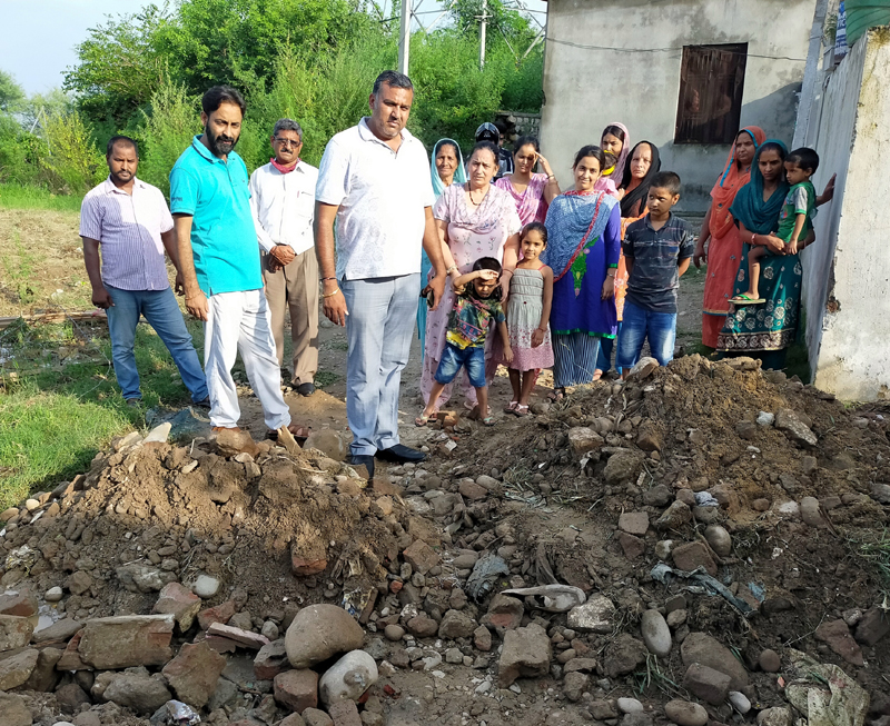 JMC Councillor Pritam Singh taking stock of the road work in Ward 50 on Wednesday.