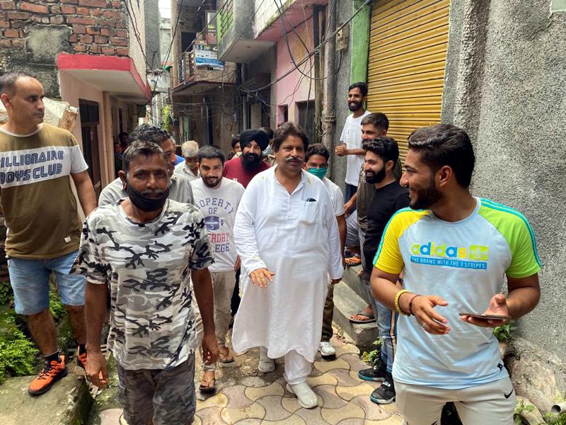 Cong leader Raman Bhalla visiting rain hit Gorakh Nagar area in Jammu.