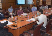 Advisor R R Bhatnagar chairing a meeting on Wednesday.