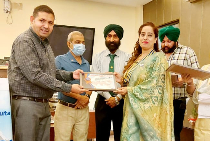 Newly elected president of Rotary Club Jammu Trikuta being awarded with memento by dignitaries in Jammu on Tuesday.