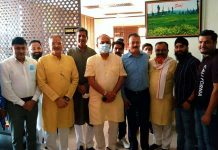 BJP leader and former Dy Chief Minister, Kavinder Gupta posing for a group photograph on Friday.