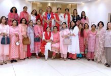 Newly installed members of Innerwheel Club Jammu District posing for group photograph.