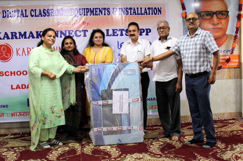Members of NGOs distributing digital classrooms to BSS schools in Jammu on Friday.