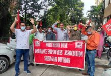 LIC employees staging protest outside divisional office of the Corporation in Jammu.