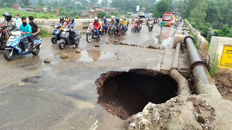 Rain damages a portion of Birwan bridge at Udhampur. — Excelsior/Pawan Gupta