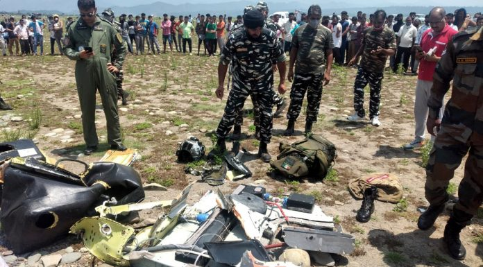 Some parts of helicopter and belongings of pilot and co-pilot recovered from Ranjit Sagar dam in Basohli on Tuesday. — Excelsior/Pardeep Sharma