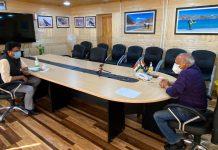 Chairman and CEC LAHDC, Kargil Feroz Ahmad Khan interacting with LG Ladakh R K Mathur. -Excelsior/Basharat Ladakhi