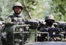 Security forces during encounter at Chandaji area of Bandipora district on Tuesday. — Excelsior/Aabid Nabi