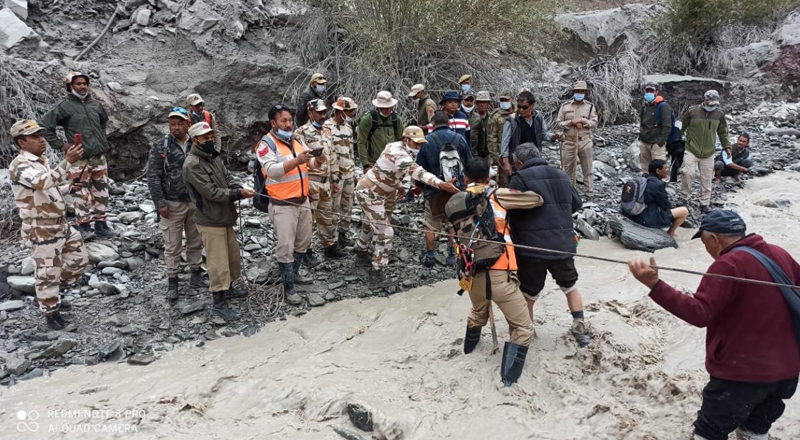 ITBP and SDRF personnel rescuing a trapped civilian at village Rumbak in Leh on Sunday. — Excelsior/Morup Stanzin
