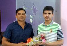 President J&K Chess Association, Atul Kumar Gupta felicitating Soham Kamotra at Jammu on Sunday.