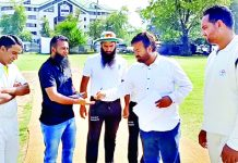Players and officials interacting before a match at TRC Srinagar on Wednesday.