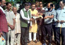 Chairman District Development Council Kathua, Col (retd) Mahan Singh kick starting construction of road in Palakh Panchyat of Basholi on Sunday.
