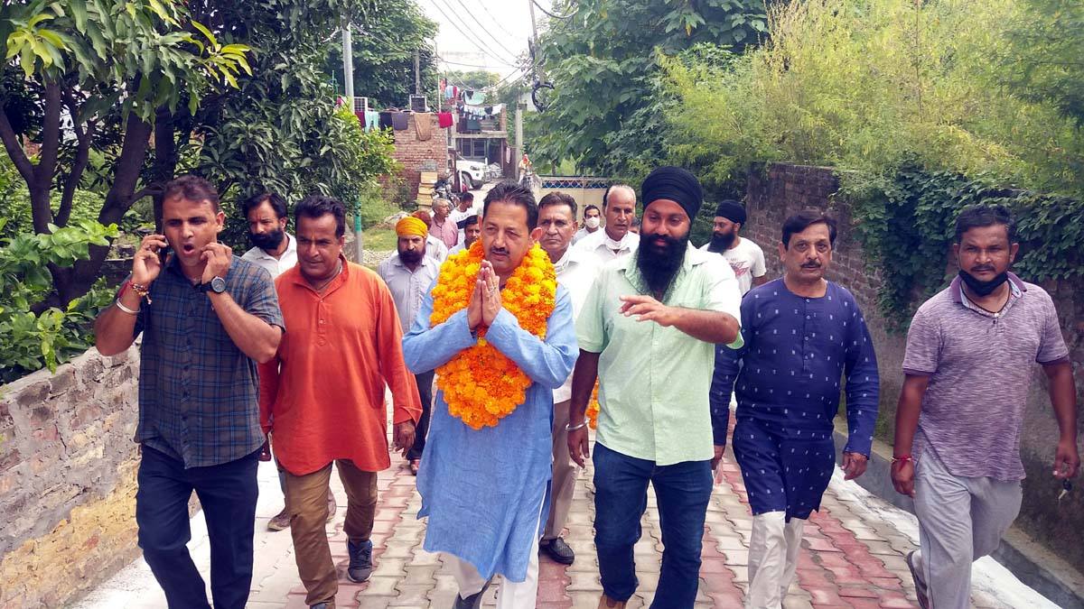 Corporator, Baldev Singh Billawaria during inauguration of lanes and drains in Gangyal on Sunday.