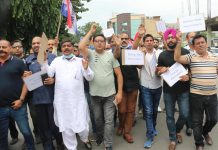 Members of Apni Party Trade Union raising slogans during protest at Jammu on Tuesday.