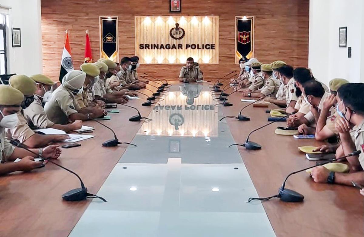 SSP Srinagar Sandeep Chaudhary chairing a meeting.