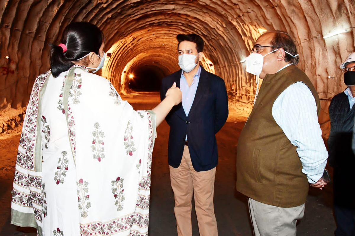 Union Minister for I&B inspecting progress on a tunnel project.