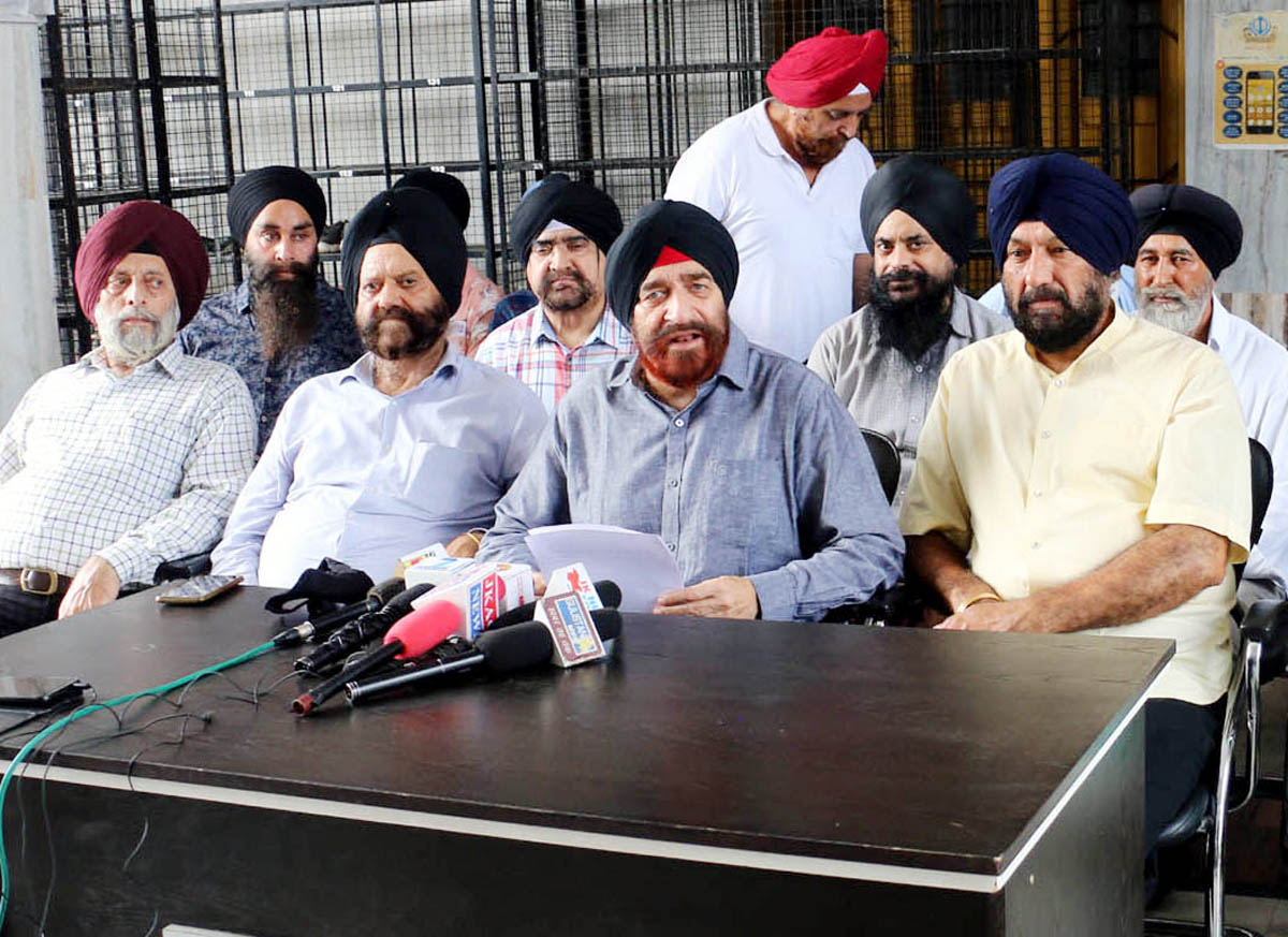 Sikh United Front J&K office bearers addressing a press conference at Jammu on Friday.