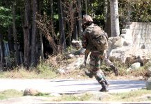 Security forces during encounter in North Kashmir's Bandipora district on Sunday. — Excelsior/Aabid Nabi