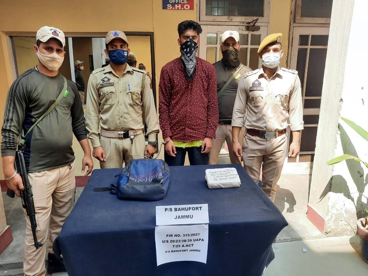 Arrested militant in police custody.