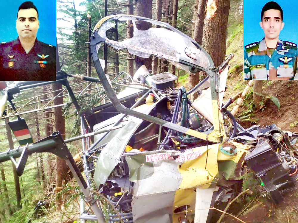 Badly damaged helicopter after crash at Patnitop and (inset) Major Rohit Kumar and Major Anuj Rajput. -Excelsior/K Kumar