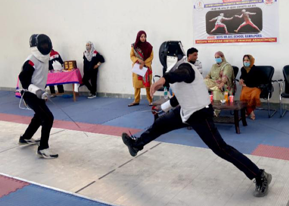 Players in action during a fencing match at Srinagar.