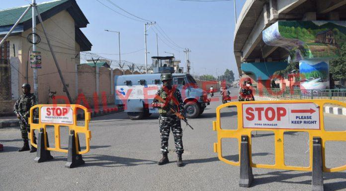Security personnel keep vigil in Srinagar City on Thursday. -Excelsior/Shakeel