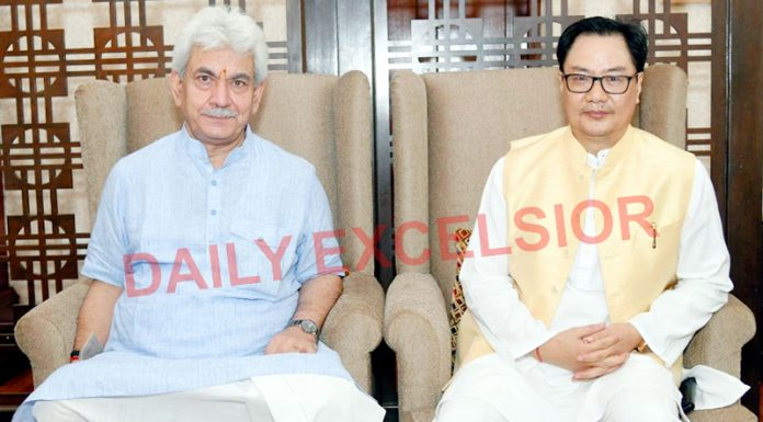 Lieutenant Governor Manoj Sinha in a meeting with Law and Justice Minister Kiren Rijiju in New Delhi on Wednesday.