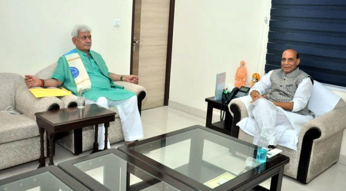 Lieutenant Governor Manoj Sinha in a meeting with Defence Minister Rajnath Singh in New Delhi on Monday.