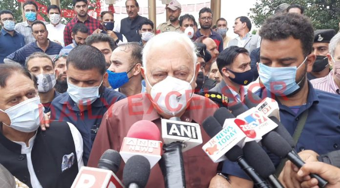 NC president Dr Farooq Abdullah speaking to reporters in Srinagar on Wednesday.
