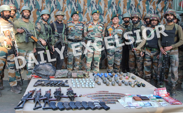 Troops with arms and ammunition recovered from three militants killed in Uri sector. —Excelsior/Abid Nabi