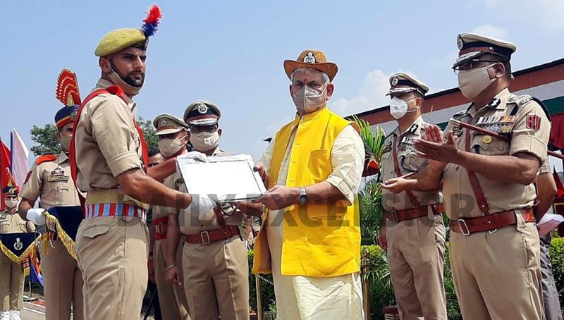 Lieutenant Governor Manoj Sinha awarding a new recruit at SKPA Udhampur on Thursday. -Excelsior/K Kumar