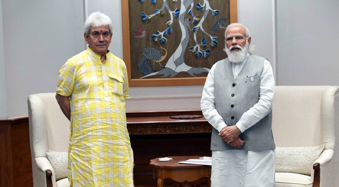 Lieutenant Governor Manoj Sinha in a meeting with Prime Minister Narendra Modi in New Delhi on Thursday. Another pic on page 4.