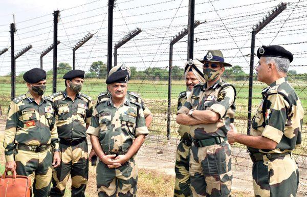 DG BSF Pankaj Kumar Singh with senior officers visiting International Border in Jammu on Friday. (UNI)