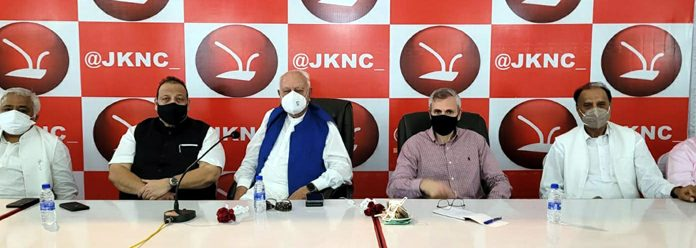 Dr Farooq Abdullah and Omar Abdullah along with NC leaders attending party meeting at Sher-e-Kashmir Bhawan in Jammu on Wednesday.