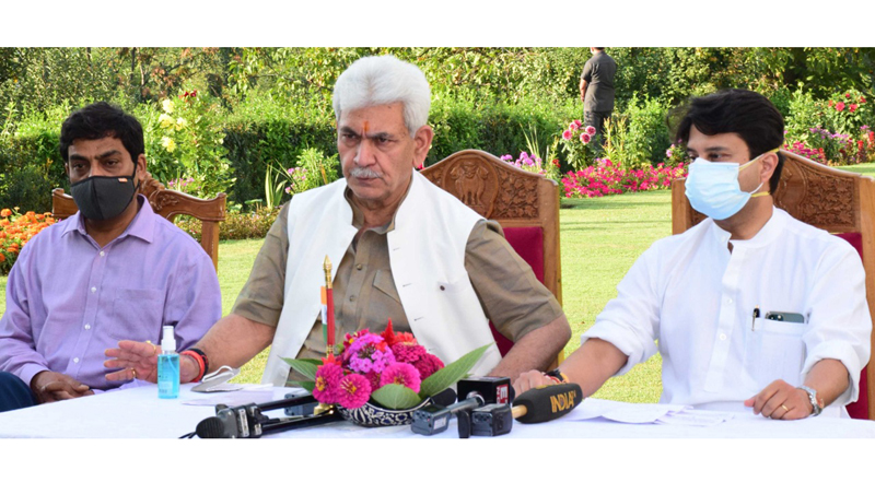 Union Minister Jyotiraditya Scindia and Lieutenant Governor Manoj Sinha at a press conference in Srinagar on Saturday.