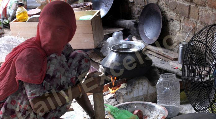A woman cooks food on a clay stove in Jammu. — Excelsior/Rakesh