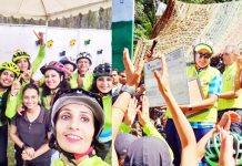 Participants of Cycle rally posing for a group photograph (L) and winner being awarded by Lt Gen D P Pandey (R) at Baramulla on Sunday.