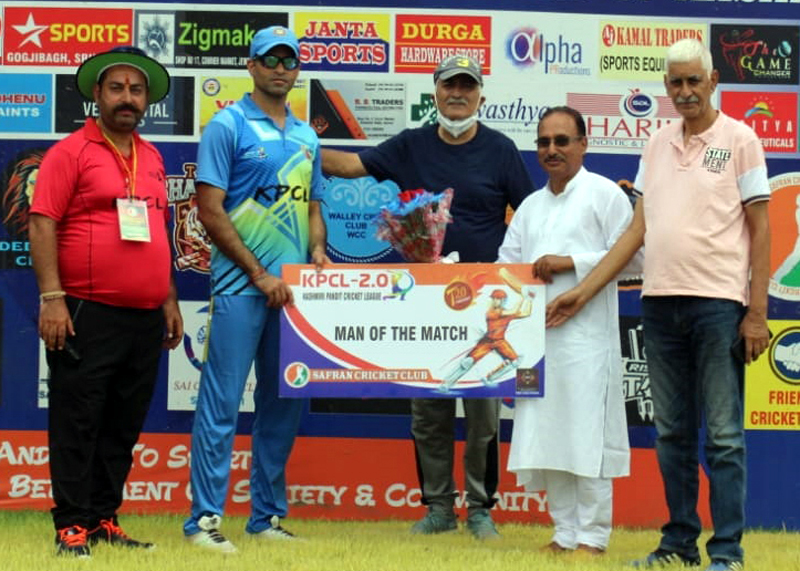A player being awarded with man of the match by dignitaries at Jammu.