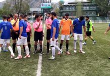 Players interacting with referees before the match at TRC Ground Srinagar on Friday.