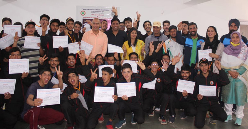 Winners displaying meritorious certificates along with dignitaries at Pahalgam.