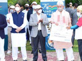 Lt Governor Manoj Sinha awarding a winner in presence of DGP Dilbag Singh at Srinagar on Sunday.