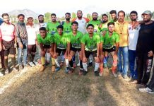 Winning team posing for a group photograph after the match at Srinagar on Friday.