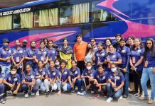 J&K Under-19 women cricket team with officials posing for a photograph before leaving from Jammu for Odisha on Monday. (UNI)