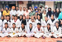 Winners posing for a group photograph along with dignitaries at Poonch.