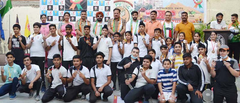 Winners posing for a group photograph with dignitaries at Jammu.