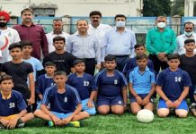Young athletes posing for a group photograph along with chief guest Rohit Khajuria and other dignitaries at Khel Gaon on Tuesday.