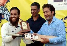 Skipper Muneeb Manaf being awarded with man of the match by organisers at Srinagar.